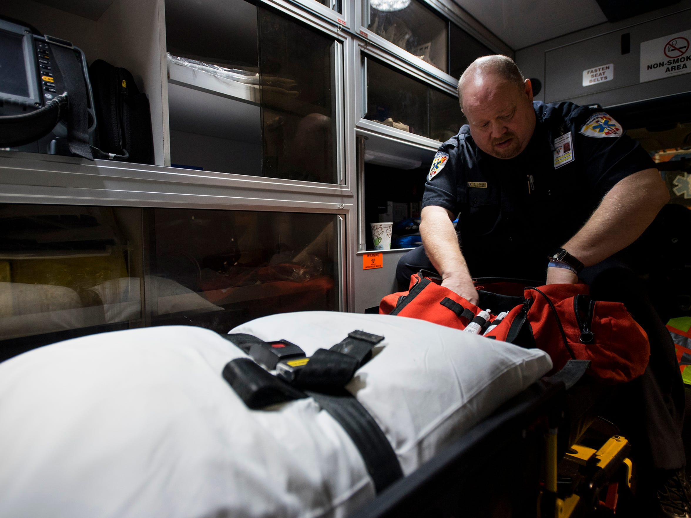 Tri-Hospital EMS Paramedic Supervisor Bill Adams checks through a kit containing a laryngoscope in the back of an ambulance Jan. 18. Paramedics use a laryngoscope to help secure an airway in an overdose victim if Narcan doesn't work.