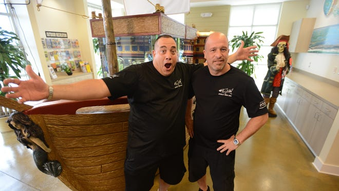 """The crew from Animal Planet's """"Tanked"""" revealed the custom aquarium Friday at the Perdido Key Area Chamber of Commerce."""