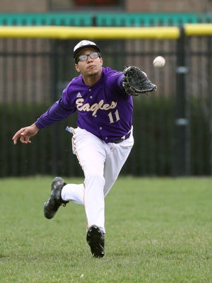 East High School centerfielder Jean Carlos Alomar catches this liner by Franklin's Jonathan Dones.