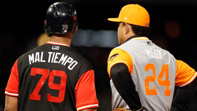 Chicago White Sox first baseman Jose Abreu (left) and Detroit Tigers first baseman Miguel Cabrera (right) wear their nicknames in honor of players weekend during the fourth inning at Guaranteed Rate Field in August.