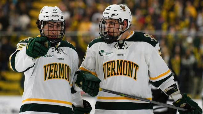 Vermont forward Alex Esposito (22) and Vermont defenseman Jake Massie (34) talk things over during the men's hockey game between the Providence Friars and the Vermont Catamounts at Gutterson Fieldhouse on Friday night February 2, 2018 in Burlington.
