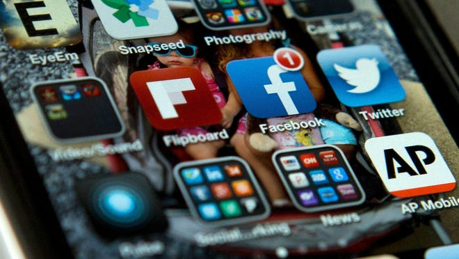 Facebook has admitted to data partnerships with device makers including Apple, Amazon, BlackBerry, Microsoft and Samsung. Evan Vucc/AP A view of an iPhone with Twitter and Facebook apps among others.