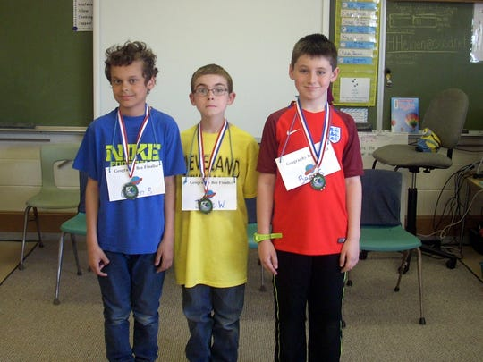 Cleveland Elementary School recently held its annual geography bee with James Woelm, middle, take first, Gaven Belekevich, left, second and Ben Summers, right, third.