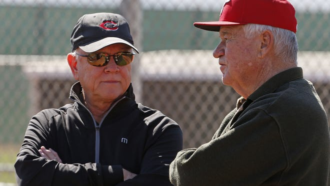 Cincinnati Reds general manager Walt Jocketty, left, and President and CEO Bob Castellini chat as they watch batting practice at their spring training and player development complex in Goodyear, Arizona Monday February 24, 2014. The Enquirer/Gary Landers