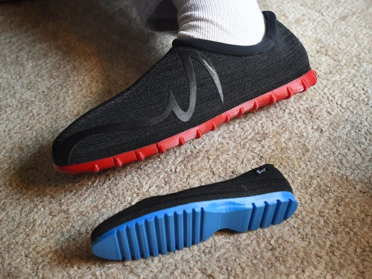 Broc Brown wears his new shoes at his grandmother's