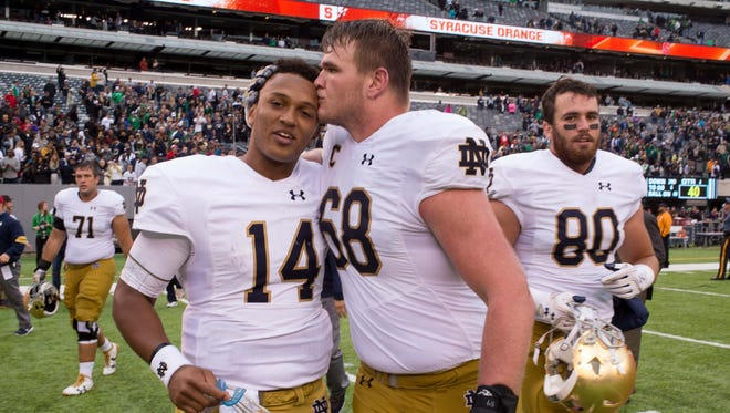Notre Dame Fighting Irish quarterback DeShone Kizer (14) is congratulated by offensive lineman Mike McGlinchey (68) after Notre Dame defeated the Syracuse Orange 50-33 at MetLife Stadium.