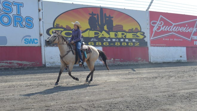 Catherine Edwards, 14, of Visalia, rides her horse at the Tulare County Fair in preparation for the rodeo.