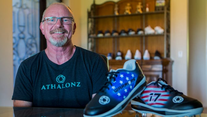 Tim Markison, founder of Athalonz, a shoe company that designs shoes that help baseball and softball players have more power and force in their stance, poses for a portrait with some of his patented shoes and their official patents in his office headquarters in Mesa on May 31, 2018. He donates a portion of sales to a nonprofit that supports child abuse victims.