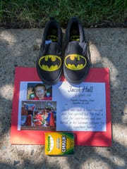 A pair of Batman slippers for Jacob Hall, a 6-year-old school shooting victim.