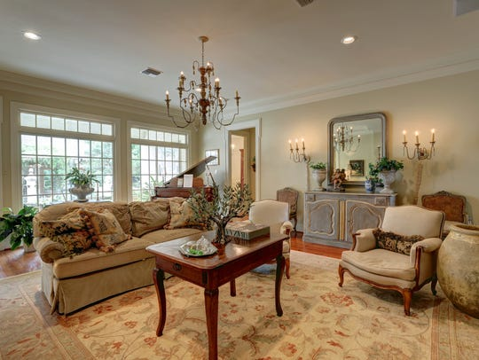 The formal living areas have views of the lovely outdoor