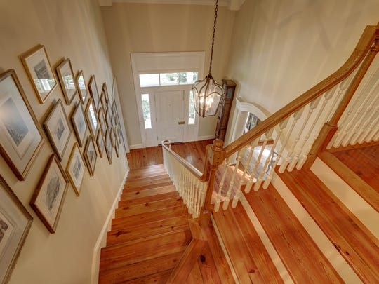 The home has two beautiful staircases for easy access.