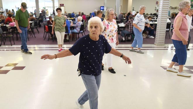 Visitors to the Muskingum County Center for Seniors danced on Thursday, during a goodbye party to the center's location in the Sunrise Center. The center's new building in downtown Zanesville opens next month.