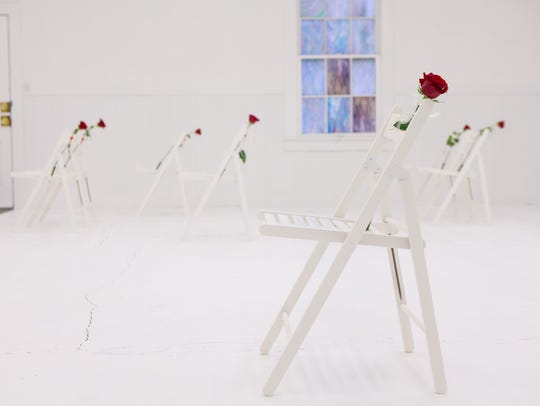 Chairs adorned with roses mark where victims were found