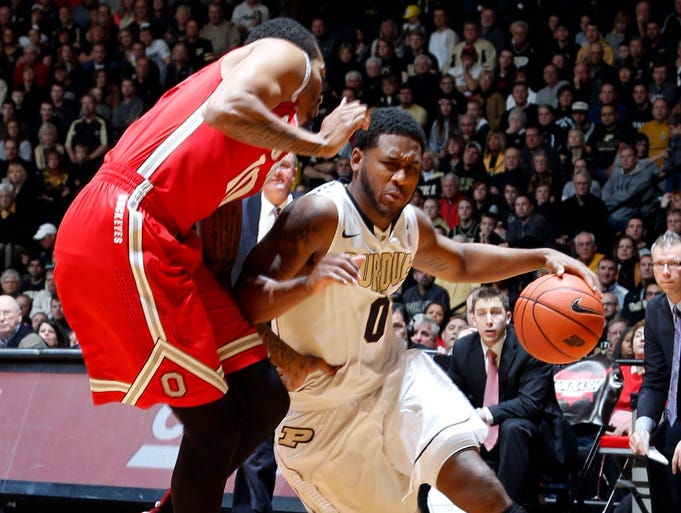 Dec 31, 2013; West Lafayette, IN, USA; Purdue Boilermakers guard Terone Johnson (0) drives to the basket against Ohio State Buckeyes forward LaQuinton Ross (10) at Mackey Arena. Mandatory Credit: Brian Spurlock-USA TODAY Sports