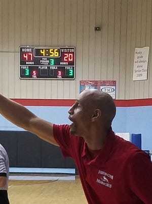 Hirschi coach Donald Hedge directs his team Friday during a 74-39 victory against Iowa Park. The Huskies wrapped up the District 6-4A title with the win.