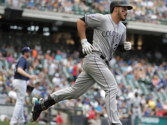 The Rockies' Nolan Arenado hits a home run during the 11th inning against the Brewers earlier this year.