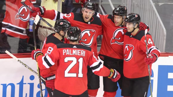 The Devils celebrate a goal scored by Jimmy Hayes in the second period.
