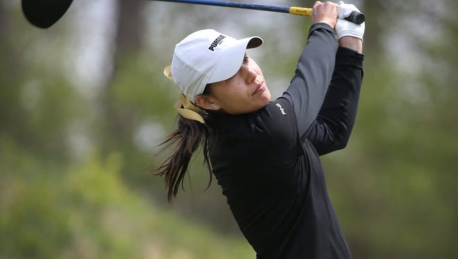 Purdue's Aurora Kan watches her tee shot on the 6th hole during the first round of the Big Ten women's golf tourney Friday, April 24, 2015, morning at The Fort Golf Course in Indianapolis.