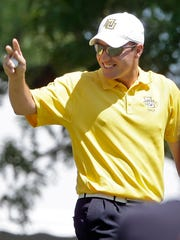 Mike Van Sickle was an all-American golfer at Marquette.