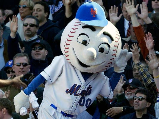 FILE - In this April 11, 2005, file photo, New York Mets mascot Mr. Met reacts with the crowd during the Mets home opener against the Houston Astros at Shea Stadium in New York. Even Mr. Met is frustrated with the team's start. New York's beloved mascot flashed an upraised middle finger at a fan during Wednesday night's, May 31, 2017, 7-1 loss to the Milwaukee Brewers, and the employee will not work for the Mets again. A Mets official told The Associated Press more than one person wears the Mr. Met costume during each season, and the person who donned it Wednesday night will not do so again. The Mets official spoke on condition of anonymity because the statement from the organization was the team's only authorized comment. (AP Photo/Gregory Bull, File)