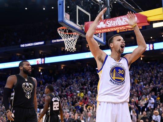 Warriors rally past Bucks to avenge only loss