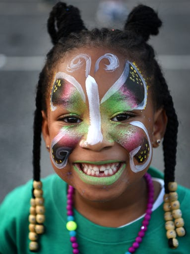 Melissa Chaplin, 4 shows off her face painting during