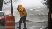 Winds were expected to remain breezy from Washington to Boston, a day after they toppled tractor trailers and exceeded 50 mph.