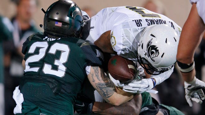 Oregon quarterback Vernon Adams Jr., center, is sacked by Michigan State's Chris Frey (23) and Demetrius Cooper, rear, during the first quarter of an NCAA college football game, Saturday, Sept. 12, 2015, in East Lansing, Mich.