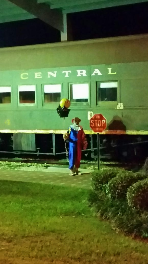 In this previously unpublished photo, the McComb Clown can be seen in front of a train station.
