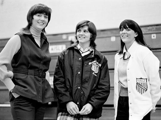 Ann Jacobs, right, Belmont women's basketball star, shows off her National Women's Invitational Tournament All-American sweater to Coach Betty Wiseman, left, and teammate Kathi Martin on March 20, 1974. The Rebelettes finished sixth in the NWIT, finishing the season 22-6. Martin was named to the All-America Honorable Mention squad.