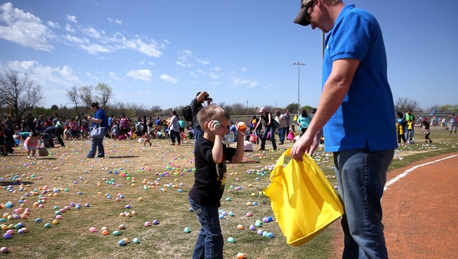 Children race to collect eggs at TLC's Easter Fest in 2016. This year's event is at 11 a.m. Saturday at the Texas Bank Sports Complex, 1651 Rio Concho Drive. It features more than 170,000 eggs, music, prizes, hot dogs, drinks, face painting, bounce houses, a rock wall, barrel train, helicopter egg drop and more.