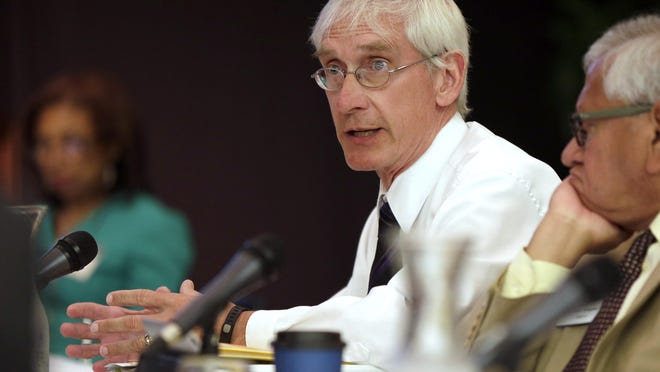 Tony Evers, Wisconsin superintendent of public instruction, speaks during a meeting of the University of Wisconsin System Board of Regents at the UW-Milwaukee Union in 2015.