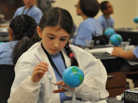 Students built a model of the moon and Earth at the annual Inspired by Science summer camp Monday, June 4, 2018. The camp is held at New Mexico State University Carlsbad campus.