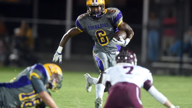 Purvis running back John Bolton  runs past the defense against East Central High School on Friday at Purvis High School.