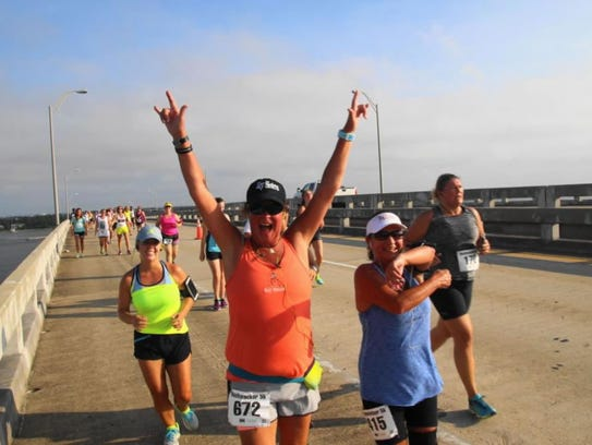 Runners cross the Santa Rosa Sound on the Bob Sikes
