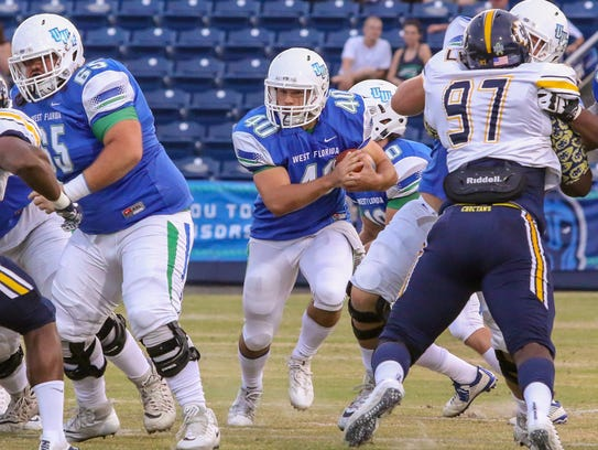 UWF running back Chris Schwarz (40) runs the ball against