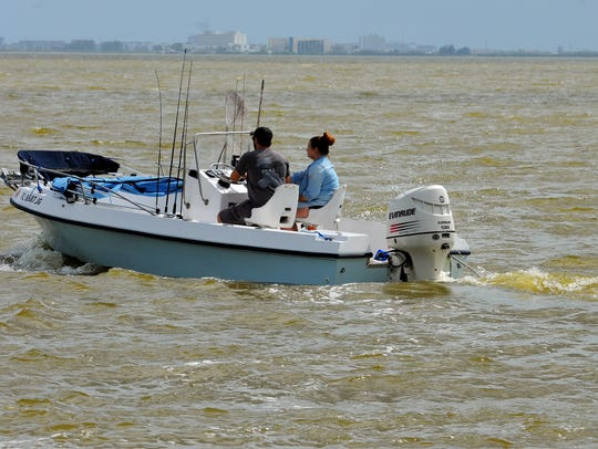 Boaters enjoy a day out on the water Tuesday in the