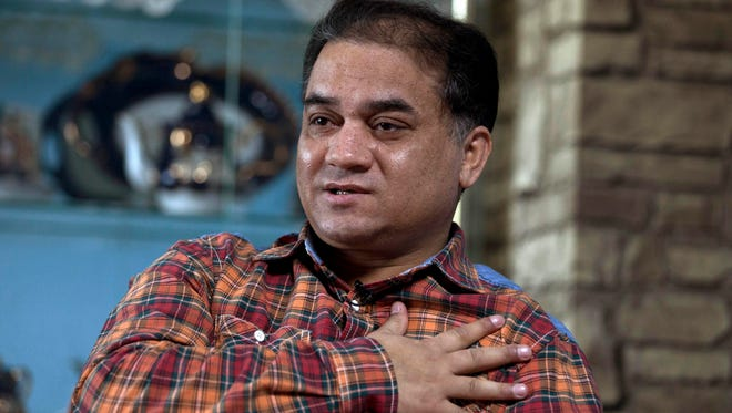 Ilham Tohti, an outspoken scholar of China's Turkic Uighur ethnic minority, speaks during an interview at his home in Beijing, China, on Feb. 4, 2013.