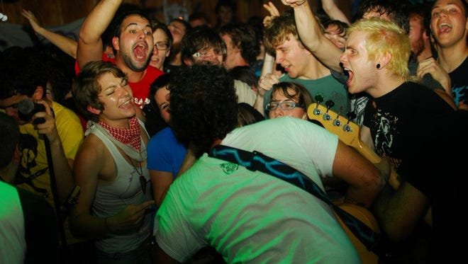 Bands and their fans are cramped together in small living rooms or basements for DIY house shows.
