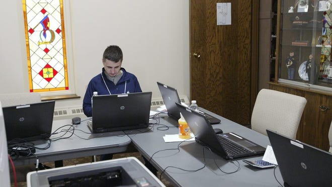 Lakeland College students have a work station at the Salvation Army where they provide free tax return service to lower-income locals.