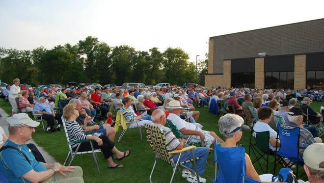Crowds gather at a past summer concert held at the Mishicot High School grounds. Mishicot's next summer concert will be at 6:30 p.m. on July 20, featuring the Sheboygan Pops Concert Band.