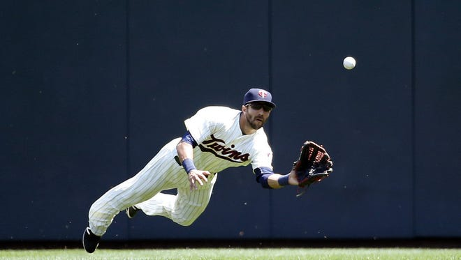 Minnesota Twins right fielder Darin Mastroianni dives for a line to right by Toronto Blue Jays' Justin Smoak during the fourth inning of a baseball game in Minneapolis, Saturday, May 21, 2016. (AP Photo/Ann Heisenfelt)