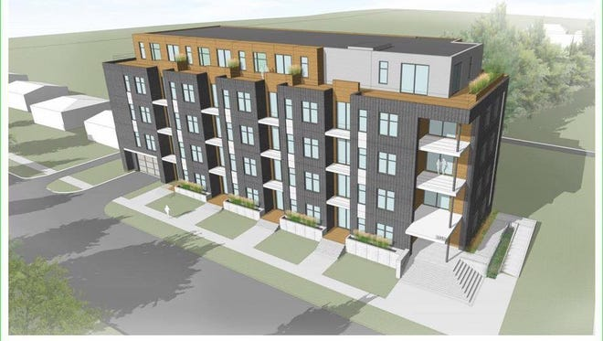 Developer and current property owner Chris Houden showed a rendering of the proposed housing development --  a five story apartment building -- during an open forum on Tuesday, Aug. 22.