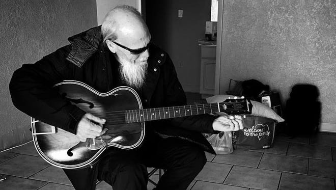 Gerald Doug Melton plays a loaner guitar from RCA the night of Dec. 21, 2016.