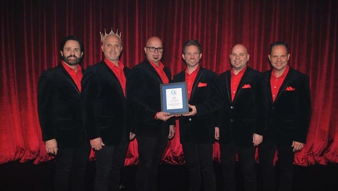 From left: Barry, Kevin, Jak, Curtis, Owen and Lynn Knudsen, of SIX, accept a plaque of appreciation from Christian Associates.