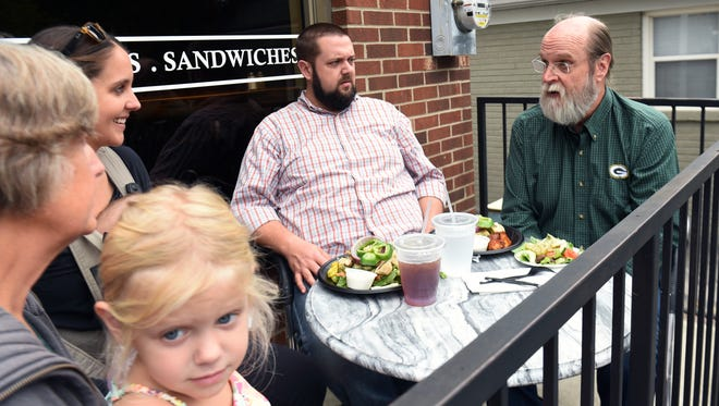 Belmont entrepreneurship professor Jeff Cornwall, right,  meets with his son, Russ Cornwall , and his daughter, Maggie Kuyper, and his wife, Ann Cornwall, and granddaughter, Lucy,4, for a lunch meeting at Kalamatas in Belmont area on Monday Sept. 28, 2015.  Cornwall is launching a new business which is a digital learning platform for entrepreneurs.