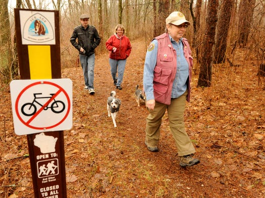 Dolly McNulty of Two Rivers, a volunteer active in the Ice Age Trail Alliance's local Lakeshore Chapter, hikes along a section of the Ice Age Trail in Two Rivers with friends. The group announced the opening of a new section of the trail near Mishicot.