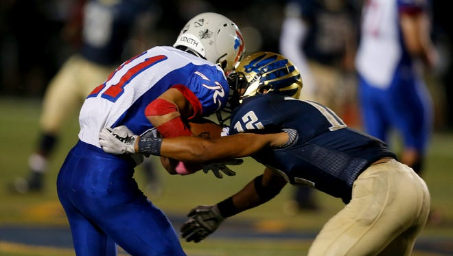 Decatur Central's Larry Tracy (12) verbally committed to IU this week.