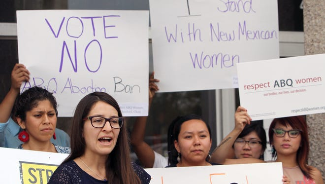 Micaela Cadena of Albuquerque speaks  against a late-term abortion ban on Aug. 13, 2013.