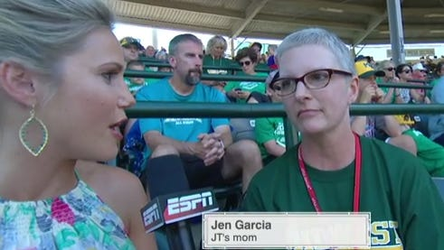 Jaymee Sire of ESPN interviews Jen Garcia as her son, JT, hits a home run during the Little League World Series. Jen traveled from Johnston while battling pancreatic cancer to see the team play in Williamsburg, Pa., on Friday, Aug. 19, 2016.